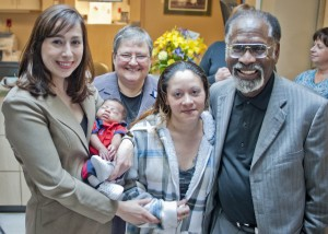 Dr. Melissa Tornero-Bold holds Baby Jayden, pictured with Sr. Stephanie Thompson, mother Tayesha Gonzalez and Dr. Alexander Boye-Doe.