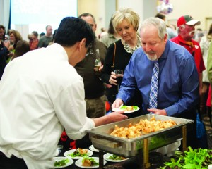 West Shore Chamber of Commerce President John Sobolewski samples delights at Best of the West.