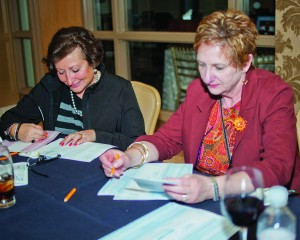 Mary Ann Dombrowiak and Ginger Vaughn tally up the totals at Best of the West. Winners will be announced in next month's live well magazine.