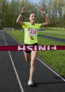 15-year old Stormie Kadar captured the ladies championship in  21:32.8