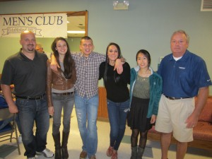 Bay Men's Club President Chris Edelman, left, and Scholarship Committee Chairperson John Stanton, right, congratulate this year's scholarship recipients (from left) Ellie Faile, Max Langer, Bridget Schwert and Rannie Dong.