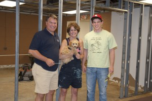 Jeff, Barbara and Brian Harrell, working at the new Village Project location on W. Oviatt in Bay Village.