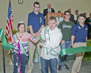 Jacob and Holly cut the ribbon at the dedication of the new Westlake High School Saturday morning.