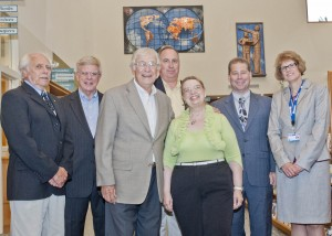 "Tom Benson, Porter Trustee President Bob Plantz, artist Don Lundstrum, Trustee Duane Van Dyke, benefactor Dr. Jeanne Bishop, Porter Library Director Andre Mangels and Truste Alayne Fodor with the newly installed Porter Public Library artwork, ""The Sky's the Limit,""  in the background."