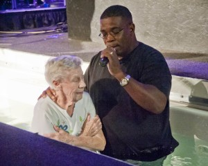 Pastor Ricardo Johnson stands in the baptismal font at Church on the Rise in Westlake.