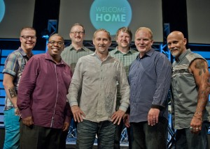 Senior Pastor Paul Endrei (center) welcomed six of his former associate pastors to the Church on the Rise 20th anniversary celebration last week. They include, from left, Pastor Peter Kerlin, Pastor Ricardo Johnson, Pastor Jim Wilkes, Pastor Jeff Davidson, Pastor Randy Phillips and Pastor Paul Grodell.