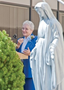 Sr. Carole Ann Griswold addresses guests at her retirement celebration in the new Garden of Peace dedicated in her honor.