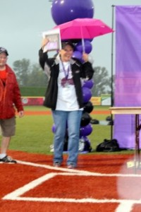 Lisa Anthony, Team Captain for Arden Courts, receives their award under her pink umbrella!