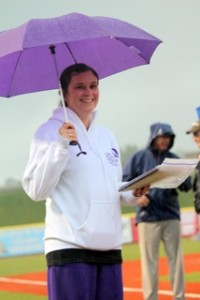 Emily Bennett, Team Captain for Life Care Center of Westlake, winners of the Largest Walk Team Award with 65 walkers, stays dry under her purple umbrella!