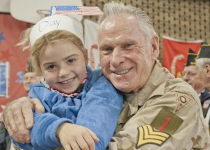 Holly Lane School student Megan Forshey with her grandpa, veteran Hank Hanisch.