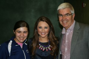 """Collins Tuohy (center) with Jim Whiteman, Principal of Westside Christian Academy (right) and Maria Netgen (left), one of WCA's 8th grade students who was inspired when Tuohy spoke at the school's Family Strong event, """"Never Lose Faith,"""" on October 18, 2013."""