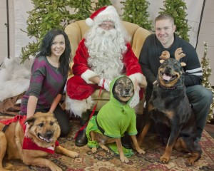 Justin Schenker and Michele Shanklin pose with Santa and their pets at the Love-A-Stray fundraiser hosted by Paws on the Lake over the weekend.