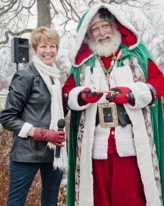 "Bay Village Mayor Debbie Sutherland presents Santa with a key to the city. ""We want to make sure he gets into everyone's house to leave gifts!"" said Mayor Sutherland."