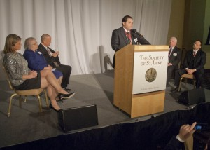 Dr. Adnan Mourany welcomes guests to The Society of St. Luke induction ceremony Sunday at LaCentre in Westlake. On stage with Dr. Mourany are (from left) Carol Sterba, Sr. Judith Ann Karam, SJMC President William Young, Dr. James H. Myers and Dr. Carlos E. Zevallos, Jr.