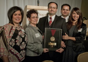 Holding the plaque - Dr. Carlos Zevallos, Jr. (right) and Mrs. Carlos Zevallos Sr. (left) with daughter Gladys Zevallos-Rummel, son Jorge Zevallos and daughter Katherine Miller.