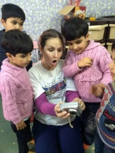 Nicki Vacco, RN, with refugee children in Jordan