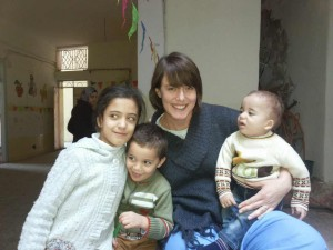 Kristin Hoops, RN, with refugee children in Jordan.