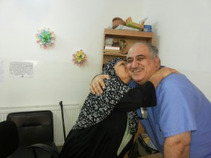 Dr. Sayed accepts gratitude from a Syrian refugee.
