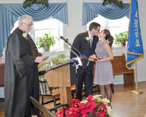 Newly sworn in Bay Village Ward 4 City Councilman Thomas Henderson celebrates his oath of office by sharing a kiss with his wife, Melissa.