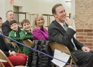 Dr. Daniel J. Keenan, Jr. and family look on as the Westlake High chorale performed at Monday's reception.