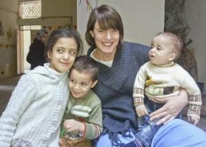 Kristin Hoops, RN, with refugee children in Jordan.