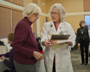 Community Outreach Nurse Brenda Schultz, RN, discusses health questions with a guest.