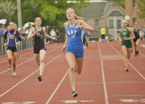 Bay's Olivia Bechtel won the 100, 22 and 400 meter dashes.