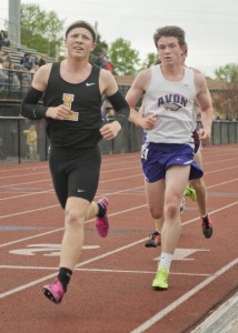 Lakewood's Nick Boatman leads the field against second place Sean Kane of Avon in the 3200. Boatman set a meet record in 9:47.61.