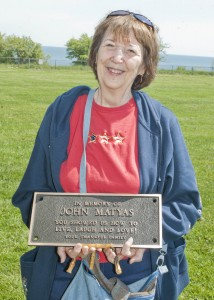 Pat Matyas with the plaque honoring her late husband, John.