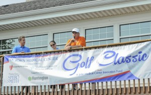 Dr. Rustom Khouri joins with Mary Khouri and Chris Burdon, Senior Development Officer SJMC in welcoming participants to the St. John Medical Center Golf Classic.