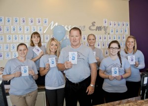Kevin Quinn, Massage Envy Westlake partner, with (from left) Deanna, Nickie, Sarah, Laura, Sarah and Kelly.