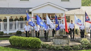 American Legion Post 211 posts the colors as (from left) Bill Burmeister, Jim Busch, John Busch, John Shook, Ward 3 councilman Larry Meiners, Mayor Gregg Zilka, Council president Marty O'Donnell, Police Chief Streator, Fire Chief Huerner, Lt. Moore and Officer Tibbitts take part in the ceremonies