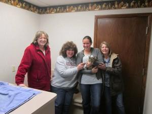 Westlake Schools  bus drivers Marge Laskowski, Denise Higgins, Leah Vandersluis and Denise Wering visit Margie the cat at the Westlake Animal Hospital.