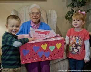 Josephine, a resident of the Knickerbocker Apartments in Bay Village, met with children from Kiddie Kollege when they stopped by with a box of Valentine's Day cards last Thursday. The cards were left at resident's dinner places that evening.