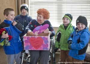 Barbara Gardner, Resident Council President, O'Neill Healthcare Bradley Bay, greets children from the Kiddie Kollege Kidz in Bloom program. The children stopped by with Valentine's Day greetings for all the residents last Friday.
