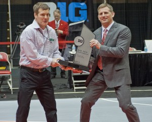 Iowa Coach Tom Brands and Ohio State Coach Tom Ryan indulged in a little tug-of-war with the 2015 Big 10 Championship trophy Sunday after the Hawkeyes and Buckeyes ended the conference tournament as co-champs.