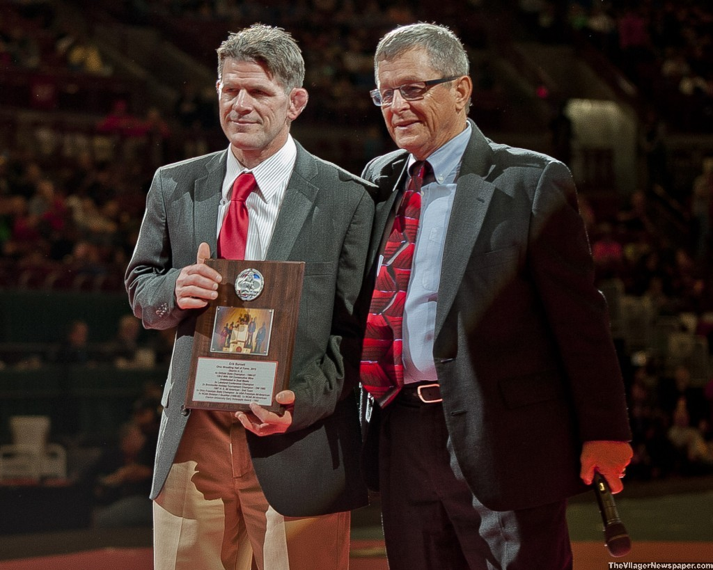 Elyria head coach Erik Burnett, inducted into the Ohio Wrestling Coaches and Officials Association Hall of Fame before the finals.