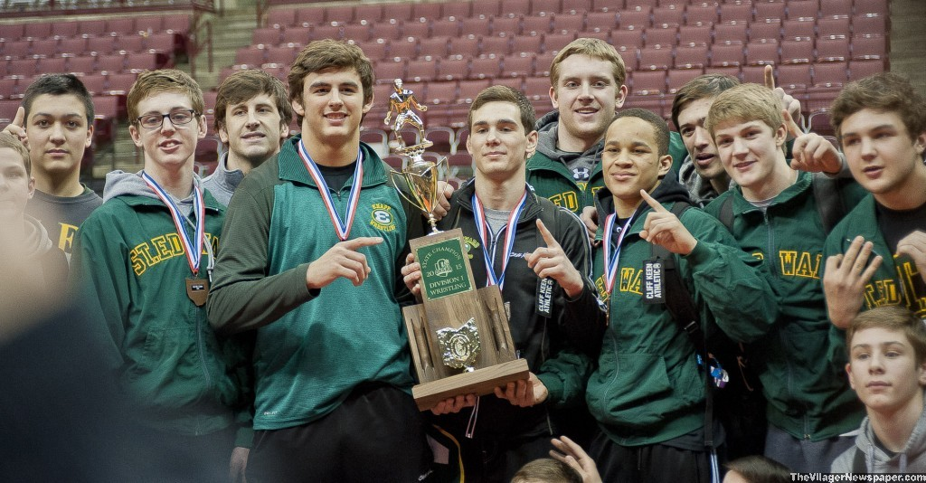 Members of the 2015 St. Edward High wrestling team pose with the Div. I state championship trophy won by the school Saturday. It is the 30th state championship for St. Edward wrestling.