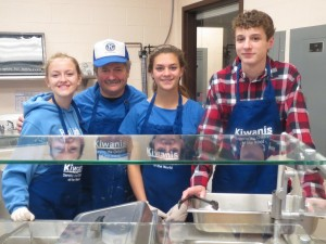 Behind the glass are (Left to right) Key Clubber Mary Wittkopf, Kiwanian Jerry Stavlas, Key Clubber Ava Almquist and Key Clubber Steven Farnham.