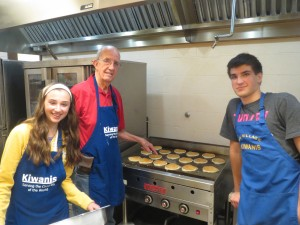 At the griddle are (Left to right) Key Clubber Vaselea Cowin, Kiwanian Don Brasted and Key Clubber Tommy Bodnar.