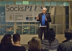 David T. Dombrowiak, President & CEO Community West Foundation, welcomed guest to Friday's SocksPlus event at 78th St. Studios.