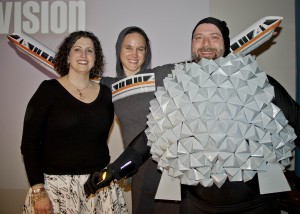 GLSC President Kirsten Ellenbogen, PhD with Yuri's Night Costume winners Chris Szhordock and Jennifer Hendricks as Epcot and Spaceship Earth.