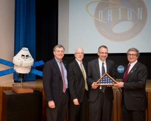 Left to right:  Lockheed Martin Orion Deputy Program Manager Larry Price, NASA Orion Program Manager Mark Geyer, NASA Glenn Research Center Director Jim Free, and NASA Orion Deputy Program Manager Mark Kirasich holding the U.S. flag that flew aboard Orion's flight test.
