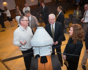 NASA Orion Program Manager Mark Geyer talks with Glenn employees Tom Goodnight and Leah McIntyre following the program.