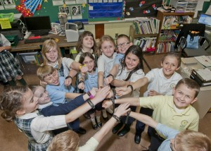 Third graders at St. Columbkille School show off their MOVbands as part of Fairview Hospital's Straight from the Heart Youth Movement contest to combat childhood obesity