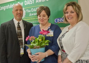 William A. Young, Jr., SJMC President and CEO and Cheryl O'Malley, SJMC Chief Nursing Officer and Vice President of Patient Care presented Sarah with the DAISY Award