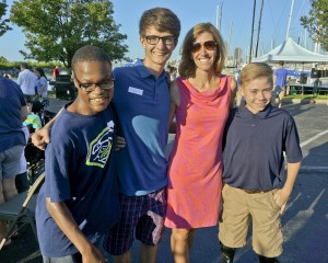 YC participant Chris Hardin, Nick Morris, Lisa and Gabe Puthoff at the Youth Challenge Regatta