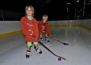 Brothers Evan and Cole Duncan on the synthetic ice.