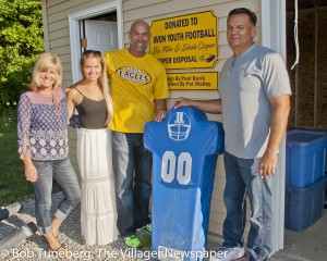Sheila, Madison and Mike Cooper with Mayor Bryan Jensen at the new youth football equipment shed.