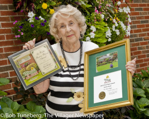 "Best in Bloom! Rita Briggs was honored with the Lu Walter Award at Westlake in Bloom ceremonies at LaCentre last Wednesday. Rita took home the Best in Bloom award to go along with Best Window Box laurels. Rita is an avid and expert gardener, richly deserving of this award that signifies the best in Westlake community pride. ""This is one of those events that brings people together to demonstrate the pride they have in our community,"" said Mayor Dennis Clough."